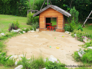Sandpit with playhouse